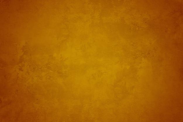 Gelber orange hintergrund mit schmutzbeschaffenheit