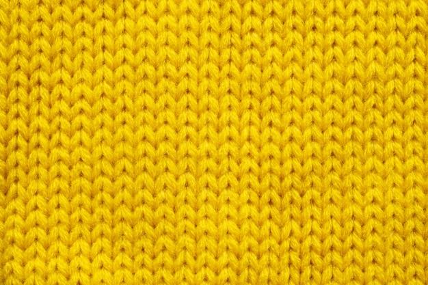 Gelber strickwollebeschaffenheitshintergrund