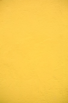 Gelber texturzementwandhintergrund
