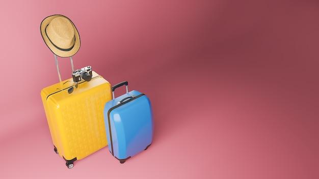 Gelber und blauer koffer mit sonnenhut, brille und kamera auf rosa