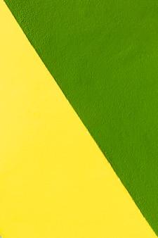 Gelber und grüner wandhintergrund