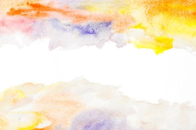 Gelber und orange aquarellfleck auf weißem hintergrund