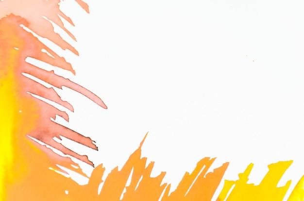 Gelber und orange pinselstrich auf weißem hintergrund