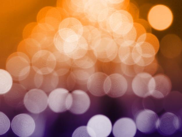 Gelber weihnachtshintergrund mit bokeh leuchten