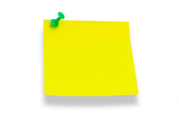 Gelbes papier auf weiße tafel geheftet