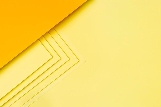 Gelbes papier formt hintergrunddesign