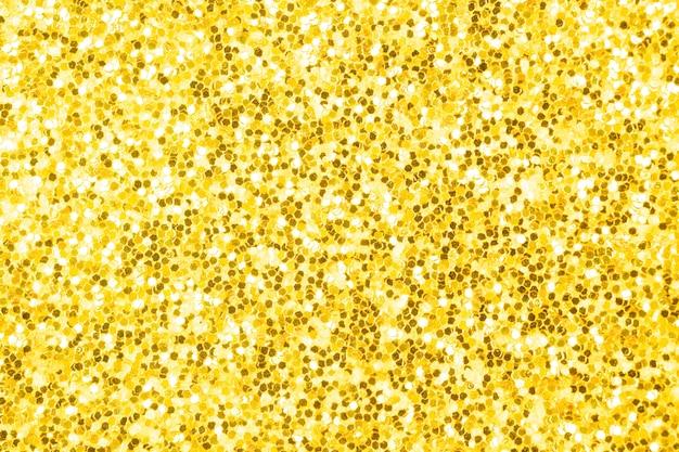 Gelbgoldenes, leuchtendes effektkonzept, glitzertexturhintergrund, sandpapper hochdetailliertes oberflächenfoto