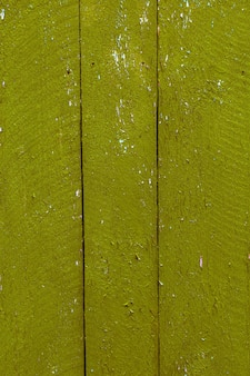 Gelbgrünes holz. farbland taiwan. gemalte hölzerne beschaffenheit.