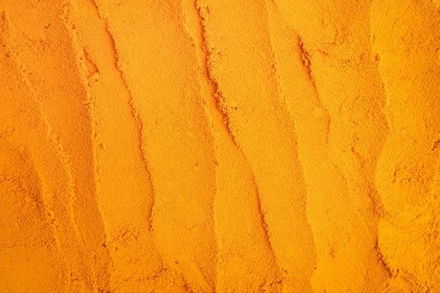 Gelbwurzpuder-beschaffenheitsnaturhintergrund