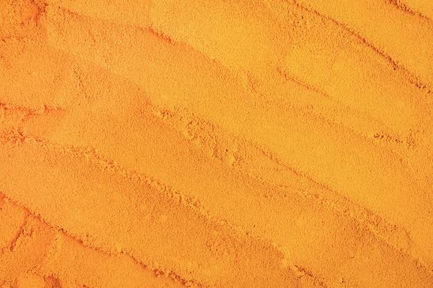 Gelbwurzpulverbeschaffenheits-naturhintergrund. kräuter