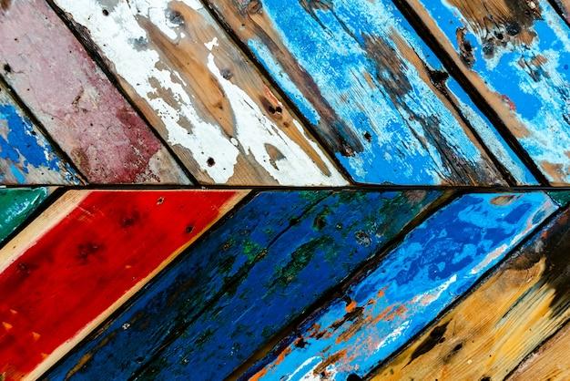 Gemalte hölzerne bretter von verschiedenen farben alterten, natürlicher beschaffenheitshintergrund.