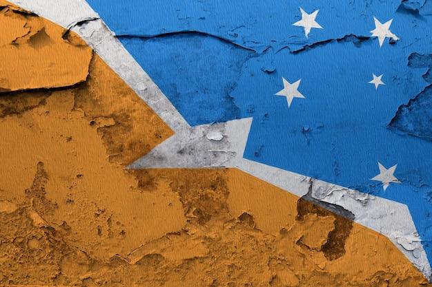 Gemalte staatsflagge von bandera de la provincia de feuerland auf einer betonmauer