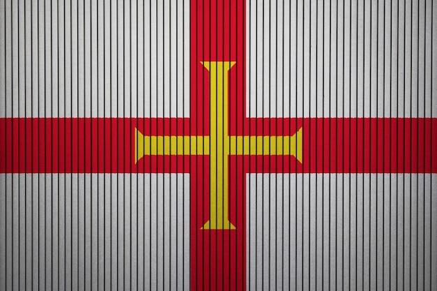 Gemalte staatsflagge von guernsey auf einer betonmauer