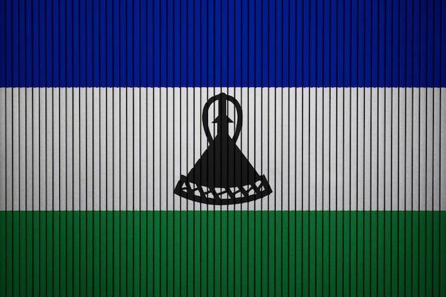 Gemalte staatsflagge von lesotho auf einer betonmauer