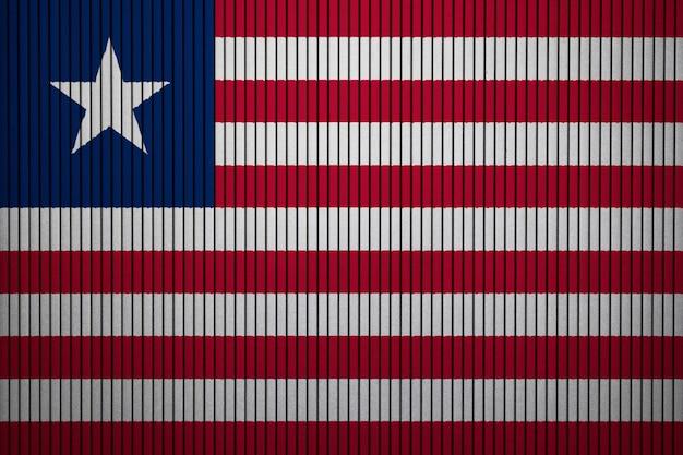 Gemalte staatsflagge von liberia auf einer betonmauer