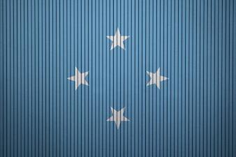 Gemalte Staatsflagge von Mikronesien auf einer Betonmauer