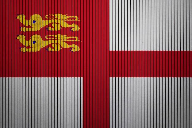 Gemalte staatsflagge von sark auf einer betonmauer