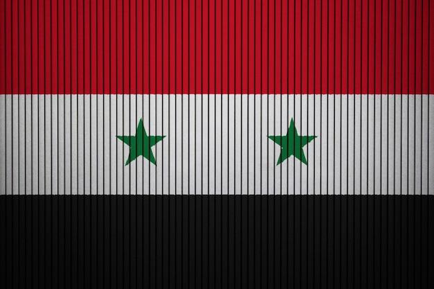 Gemalte staatsflagge von syrien auf einer betonmauer