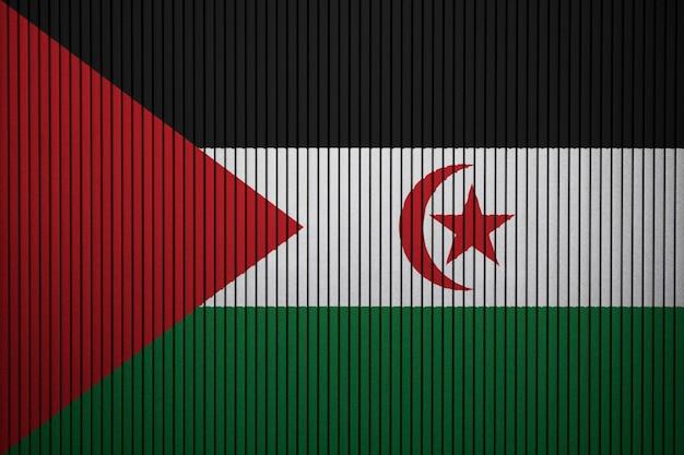 Gemalte staatsflagge von westsahara auf einer betonmauer