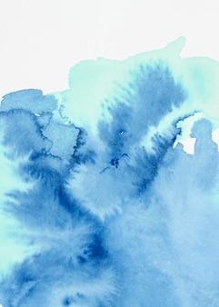 Gemischter strukturierter hintergrund des blauen aquarells