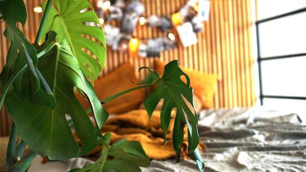 Gemütliches zimmer. heimpflanze im fokus. unscharfer hintergrund - holzwand mit lichtern und fotos über dem bett.