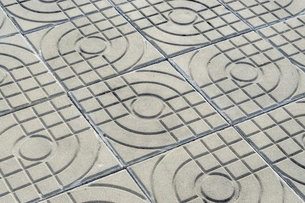 Gemusterte pflasterziegel, zementziegelsteinbodenhintergrund