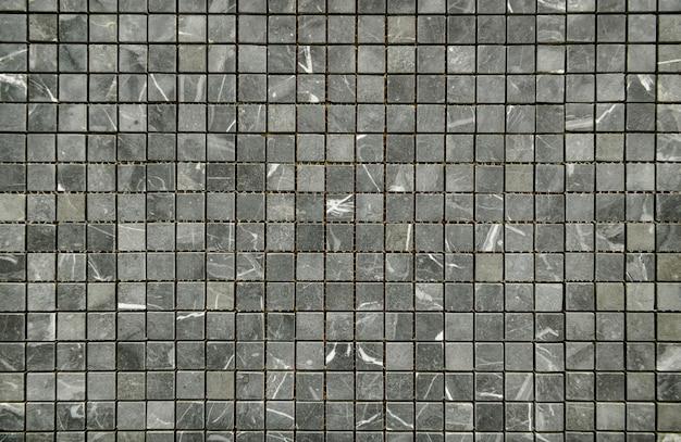 Gemusterte wand der klassischen mosaikfliesen