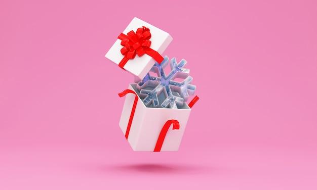 Geöffnete geschenkbox mit eisiger schneeflocke auf rosa studiohintergrund