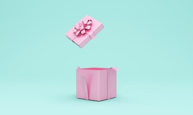 Geöffnete rosa geschenkbox auf türkis