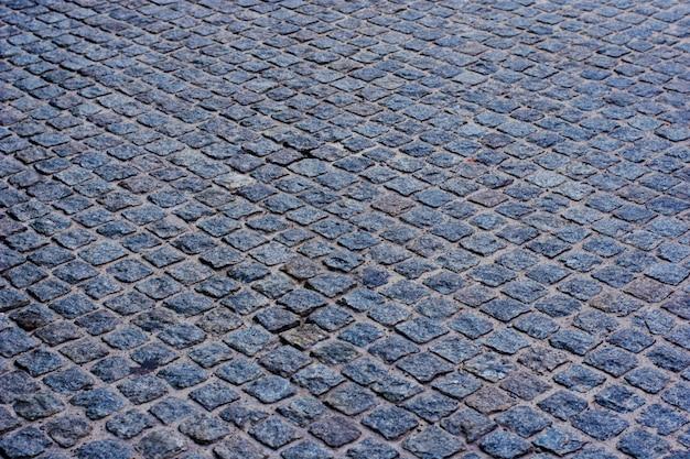 Geometriemuster der traditionellen steinpflasterung des kopfsteins