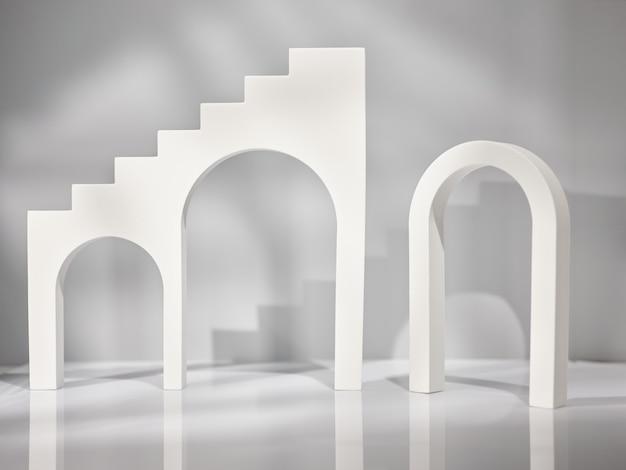 Geometrischer grauer und weißer hintergrund für produktpräsentation