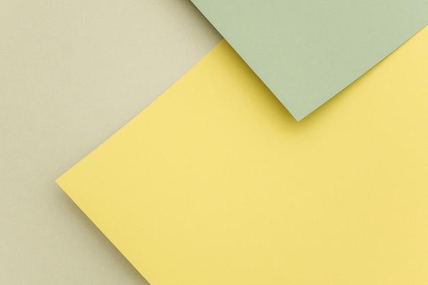Geometrischer papierhintergrund, beschaffenheit von grünen schatten.