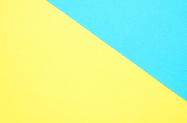 Geometrischer papierhintergrund. gelb und türkisfarbpapier-beschaffenheitshintergrund.