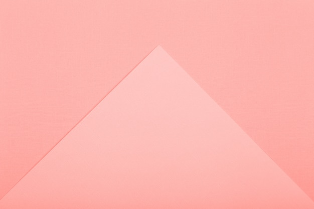 Geometrischer papierhintergrund. lebendiges korallenfarbenes modell für flache liegen