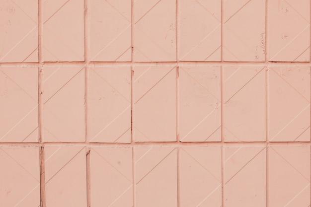 Geometrisches muster der weichen orange fliese. textur der rosa pastellkeramik gekachelt.