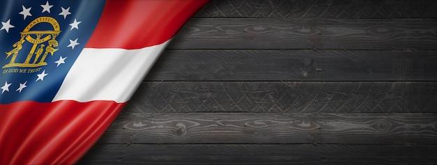 Georgia-flagge auf schwarzem holzwandbanner, usa. 3d-illustration