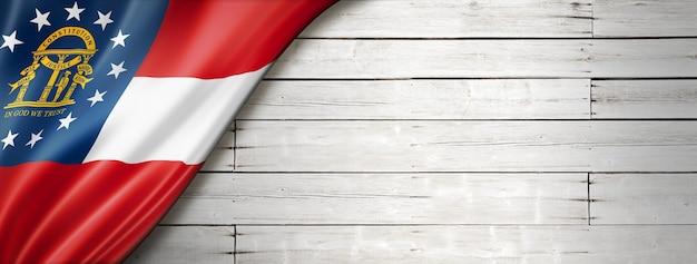 Georgia-flagge auf weißer holzwandfahne, usa. 3d-darstellung