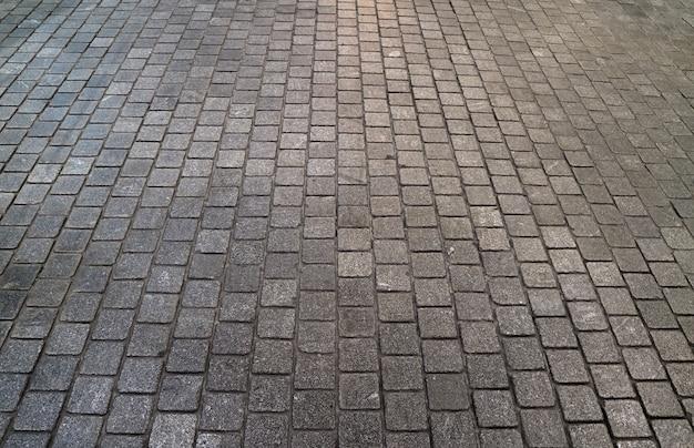 Gepflasterte bahn des betonblocks für hintergrund, muster