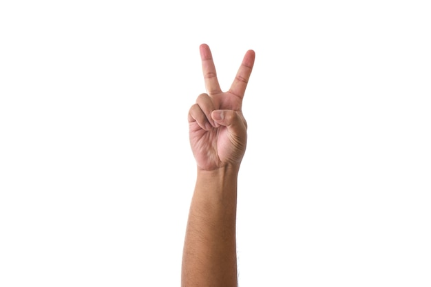 Gepflegte hand, die das zeichen des sieges und des friedens zeigt