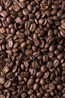 Geröstete bohnen des geschmackvollen kaffeehintergrundes