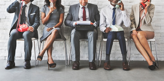Geschäfts-arbeiters-korporatives sitzendes konzept