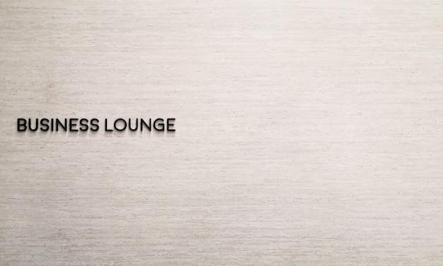 Geschäftsaufenthaltsraumkennsatzname auf marmorwand