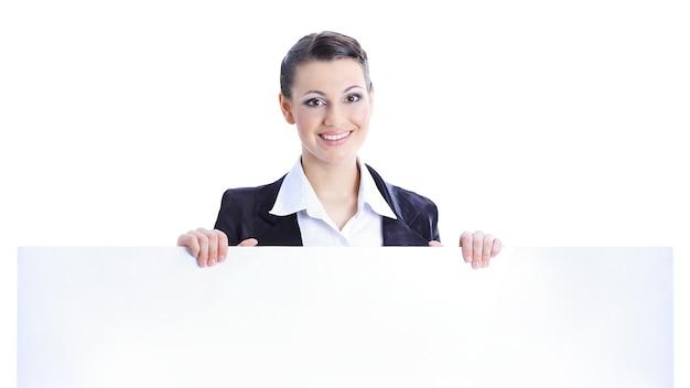 Geschäftsfrau, die großes leeres banner hält Premium Fotos
