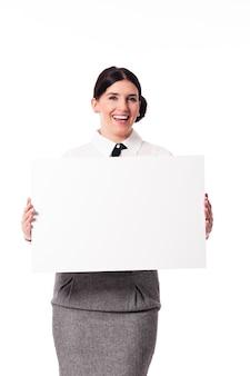Geschäftsfrau, die leeres zeichen hält