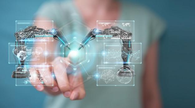 Geschäftsfrau, die roboterarme mit digitalem schirm verwendet