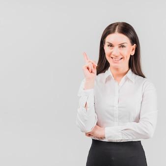 Geschäftsfrau, die zeigefinger zeigt