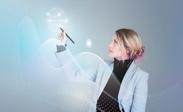 Geschäftsfrau in einem seminar, das ein diagramm zeichnet