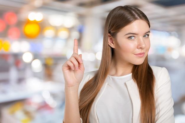 Geschäftsfrau mit finger beiseite