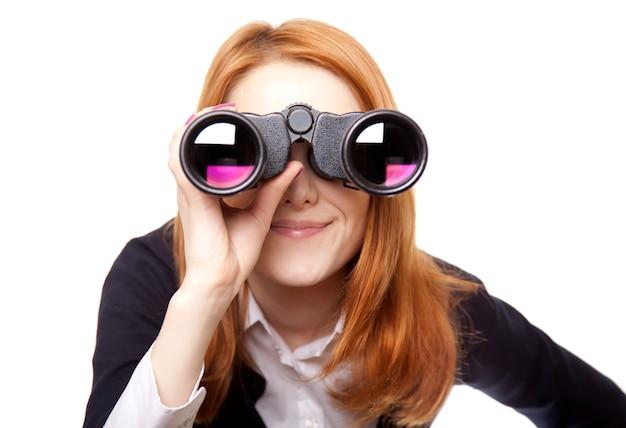 Geschäftsfrauen, die mit binokularem suchen