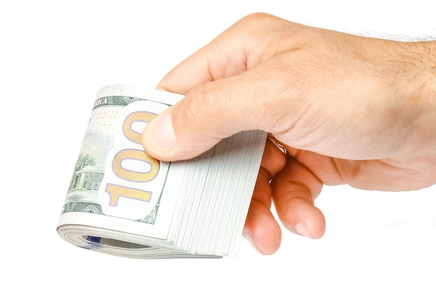 Geschäftsgeld dollar in den händen auf einer weißen oberfläche Premium Fotos